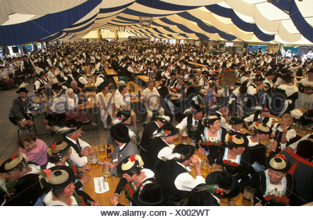 Attendees dressed in traditional costume sitting in the festival tent during the Loisachgau Festival in Egling, Upper Bavaria,  - Stock Photo
