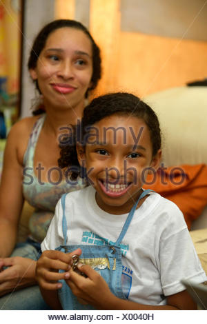 Girl and mother in a slum or favela, Jacarezinho favela, Rio de Janeiro, Rio de Janeiro State, Brazil - Stock Photo