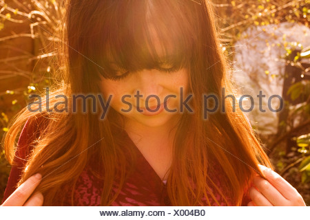 Girl playing with hair - Stock Photo