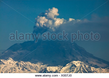 Alaska. Mt. Redoubt emitting steam and ash as viewed from Nikiski. - Stock Photo