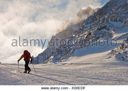 A man ski tours along the French/Haig Robertson Traverse, Peter Lougheed Provinicial Park, Kananaskis, Alberta, Canada - Stock Photo
