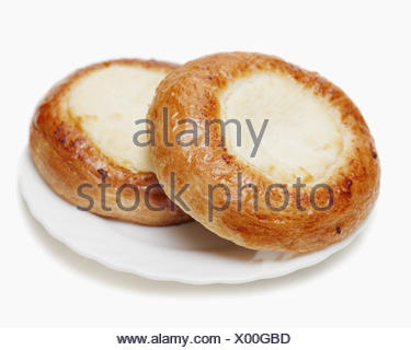 Fresh buns muffins with cottage cheese on white background. Closeup. - Stock Photo