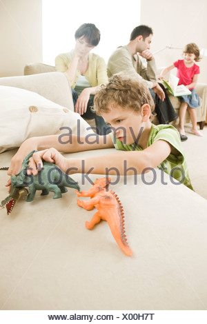 parents arguing in front of children - Stock Photo