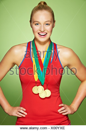 Young woman wearing medals - Stock Photo