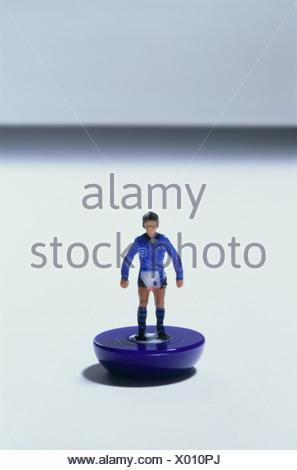 A plastic toy footballer - Stock Photo