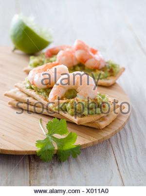 Guacamole and shrimp canapés - Stock Photo