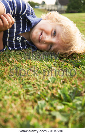 Young boy playing in garden - Stock Photo