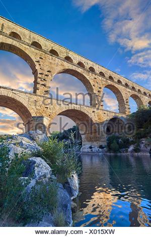 Picture of the ancient Roman Aqueduct of the Pont du Gard which crosses the River Gardon near Vers-Pon-du-Gard, France. Part of the 50 km long - Stock Photo