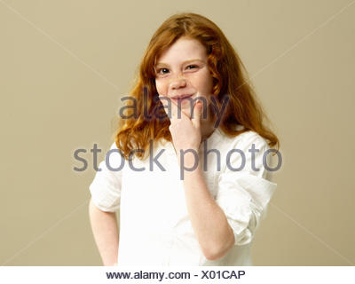 Girls, red-haired, gesture, thoughtfully, portrait, child, long-haired, blouse, shirt, freckles, hand, chin, brood, doubt undecided, think, consider, tricky, facial play, grimace, young persons, youth, childhood, studio, - Stock Photo