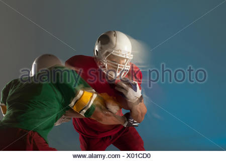 Blurred view of football players with ball - Stock Photo