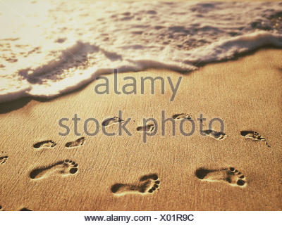 USA, California, Orange, Laguna Beach, Footprints on sand - Stock Photo