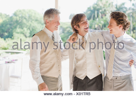 Groom and groomsmen hugging - Stock Photo