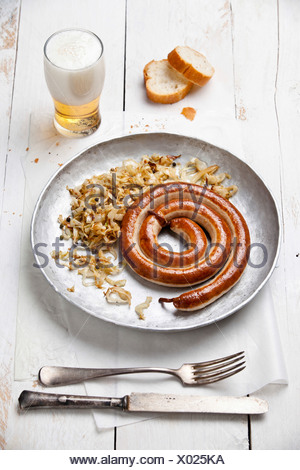 Roasted sausage with stewed cabbage and beer - Stock Photo