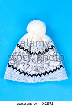 knitted wool hat with the pattern - Stock Photo
