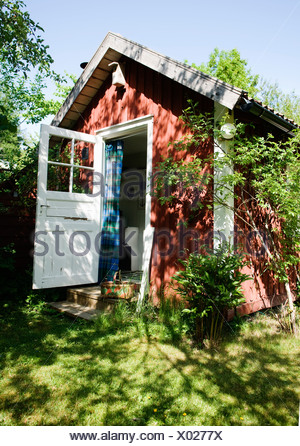 Red house with open door - Stock Photo