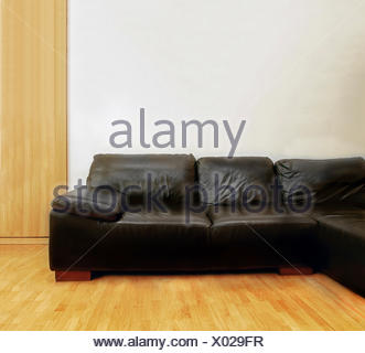 Black leather couch - Stock Photo