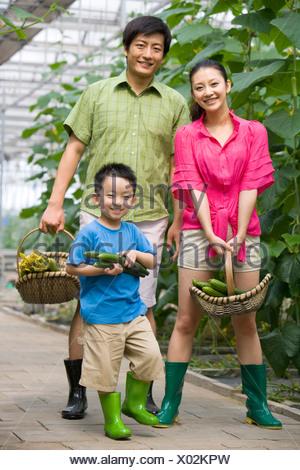 Family gardening in modern farm Stock Photo