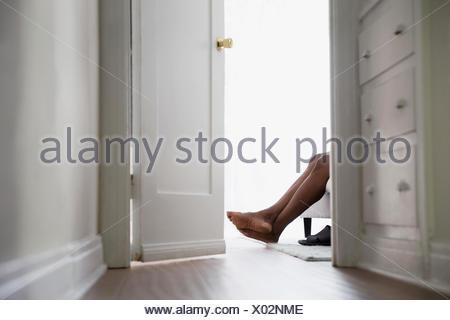 Bare feet of man in bedroom doorway - Stock Photo