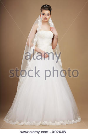 Wedding. Beautiful Graceful Bride in White Long Dress and Viel - Stock Photo