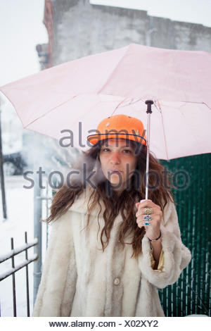 Young woman in the snow - Stock Photo
