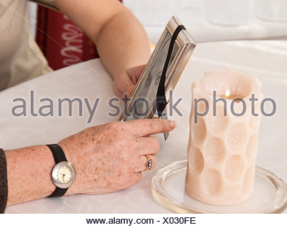 Woman comforting a widow after death. Bereavement support. - Stock Photo