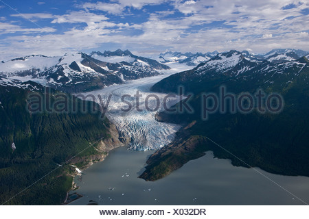 Aerial of Mendenhall Glacier winding its way down from the Juneau Icefield to Mendenhall Lake in Tongass National Forest, Alaska - Stock Photo