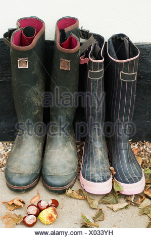 Two pairs of wellington boots - Stock Photo