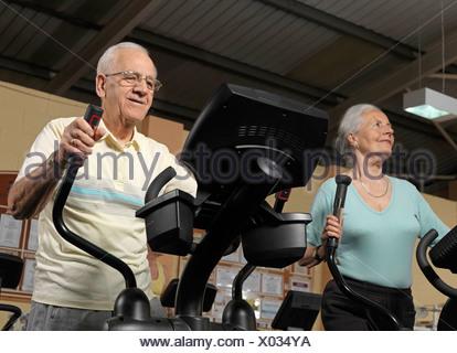 senior couple training at gym - Stock Photo