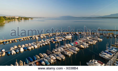 aerial view on Geneva Lake and the marina in Prangins with many boats anchored and a view in the right-hand side background on the castle of Nyon and also on the Salève and other mountains. - Stock Photo