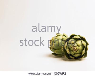Artichokes on white background - Stock Photo