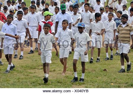 Boys wearing white school uniforms, Galle, Sri Lanka, Ceylon, Asia, PublicGround - Stock Photo