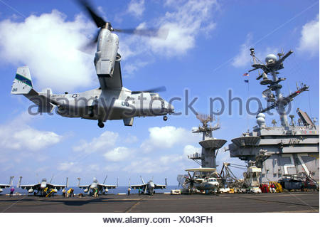 GULF OF OMAN (Oct. 15, 2013) An MV-22 Osprey assigned to Marine Medium Tiltrotor Squadron 166 lands aboardf the aircraft - Stock Photo