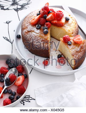 Plate of rose cake with berries - Stock Photo