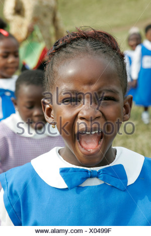 Girl wearing a uniform yelling loudly, Pre-school children during morning exercise, Buea, Cameroon, Africa - Stock Photo