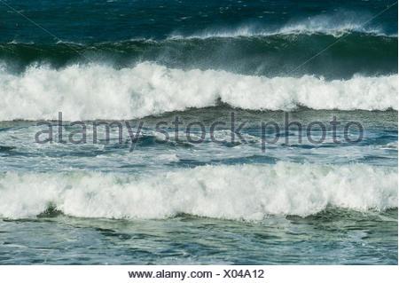 Cresting ocean waves. - Stock Photo