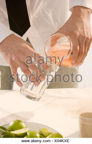 Barkeepers, detail, hands, cocktail, glass, pour, - Stock Photo