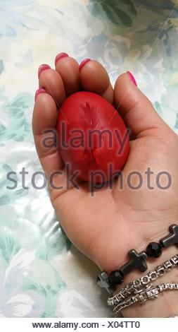Red Easter Egg In Woman's Hand - Stock Photo