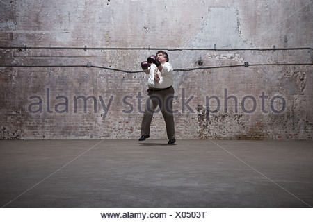Man standing in warehouse - Stock Photo