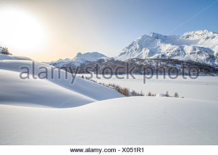 Landscape rounded by heavy snowfall overlooking Piz de la Margna, Canton of Graubunden, Engadine, Switzerland, Europe - Stock Photo