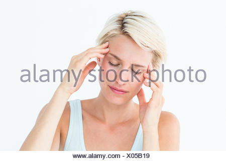 Pretty blonde with headache touching her temples - Stock Photo