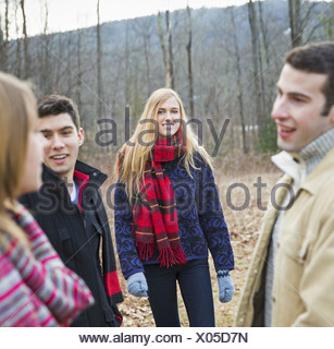A group of four people outdoors on a winter day. - Stock Photo