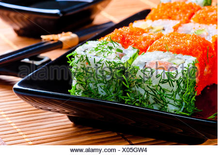 beautiful delicious rolls and black tableware - Stock Photo