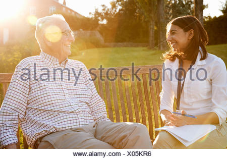 Woman Visiting Senior Male Relative In Assisted Living Facility - Stock Photo