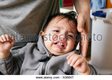 Portrait of crying little boy - Stock Photo