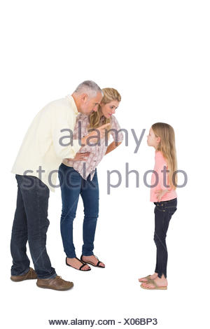 Parents telling off their bold daughter - Stock Photo