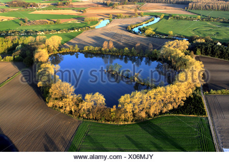 lake sourrounded by trees, river bend of Lippe river in cultural landscape in evening light, Germany, North Rhine-Westphalia, Ruhr Area, Waltrop - Stock Photo