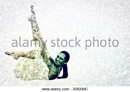 Composite image of fit woman stretching body in fitness studio - Stock Photo