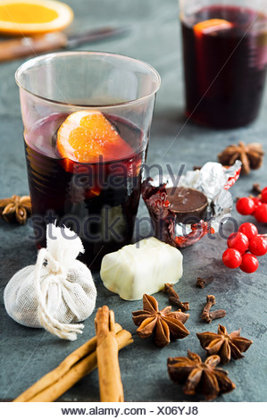 Mulled wine with spices and chocolates - Stock Photo