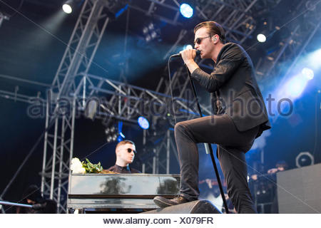 Singer Theo Hutchcraft and pianist Adam Anderson from the British synth-pop band Hurts performing live at Heitere Open Air in - Stock Photo