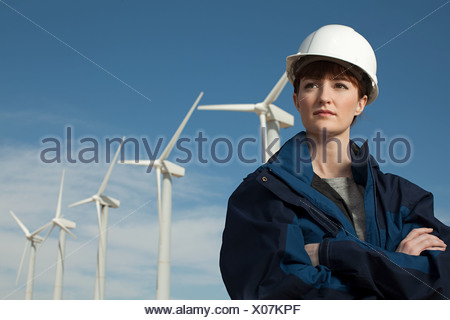 Female engineer at wind farm - Stock Photo